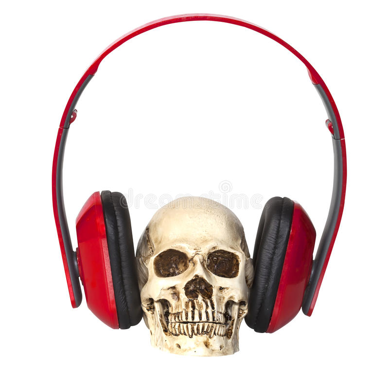 Crâne humain avec des écouteurs photo libre de droits