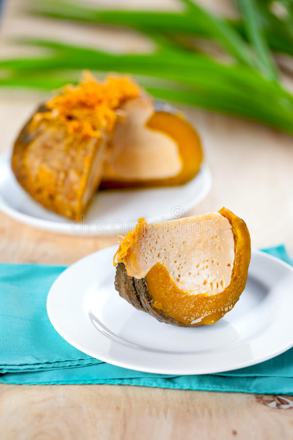 Crème anglaise thaïlandaise en potiron de courant, dessert thaïlandais images libres de droits