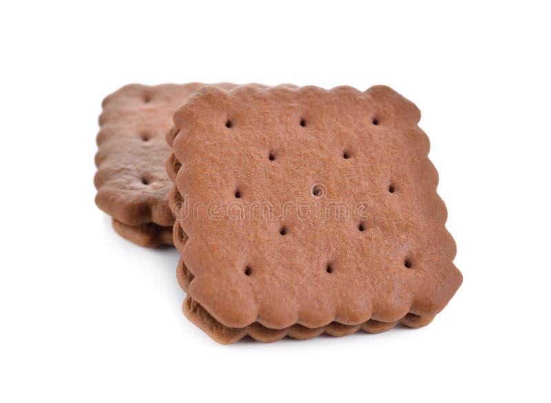 Crème assaisonnée par chocolat de sandwich à souffle sur le blanc photos stock