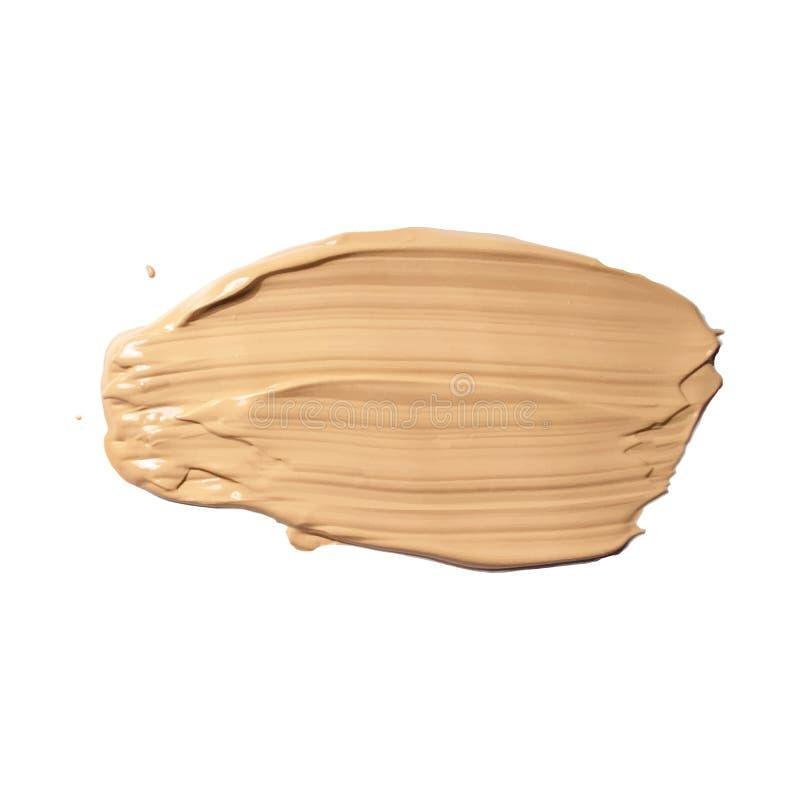 Crème cosmétique, calomnie de crayon correcteur d'isolement sur le blanc La crème liquide de ton de base a taché, texture brune d photos stock