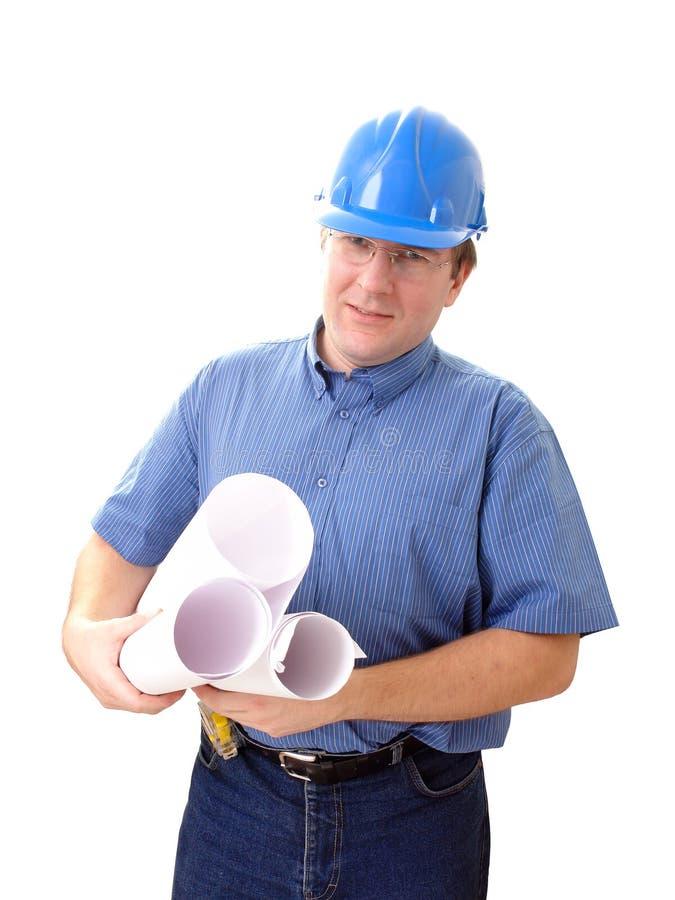 Créateur de construction avec des plans de construction photographie stock