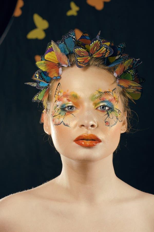 Créatif composez comme le papillon photographie stock libre de droits