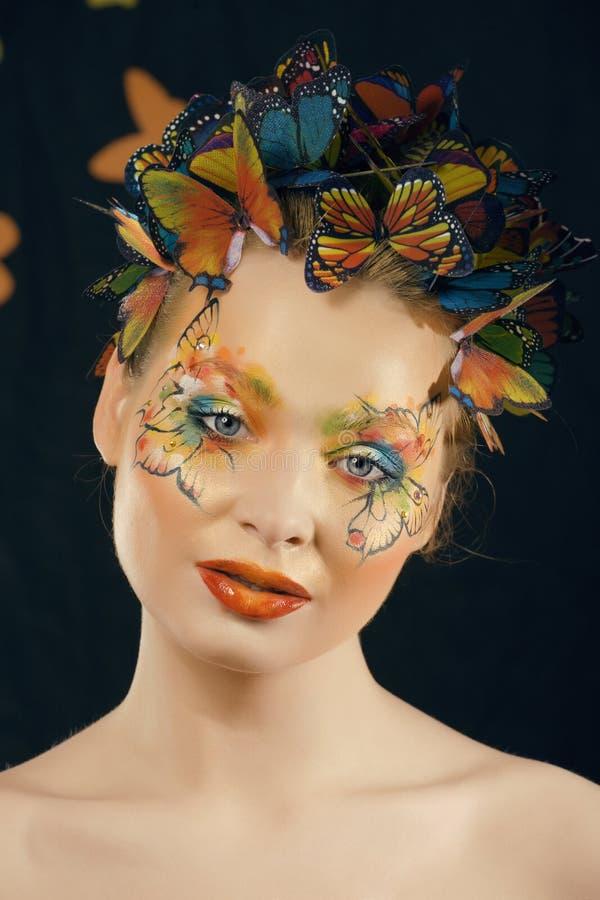 Créatif composez comme le papillon images stock