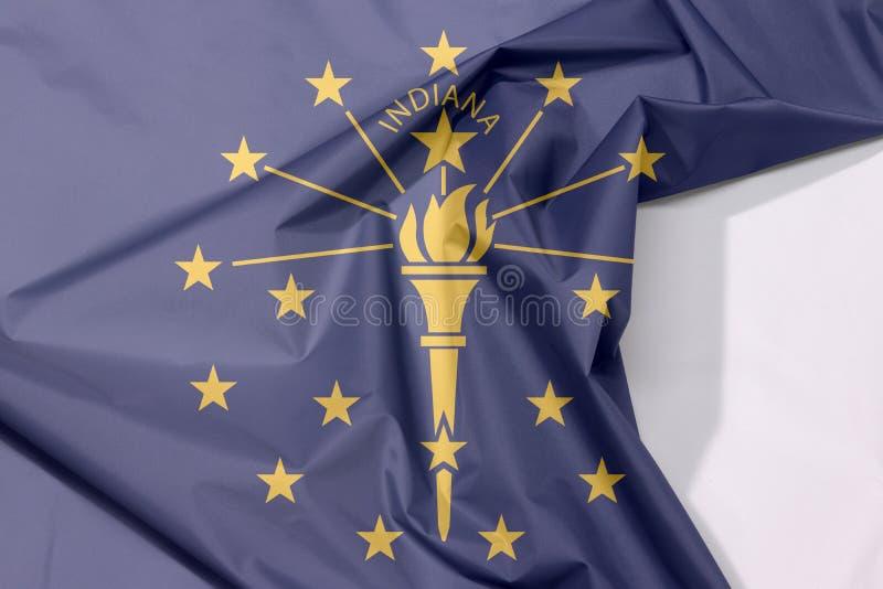 Crêpe della bandiera del tessuto dell'Indiana e piega con spazio bianco, gli stati dell'America immagini stock