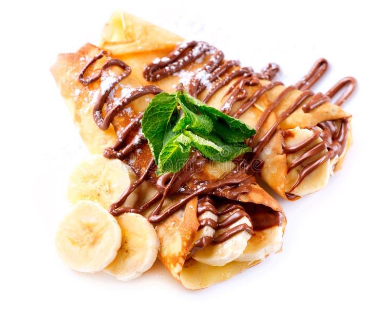 Crêpes avec la banane et le chocolat photographie stock libre de droits