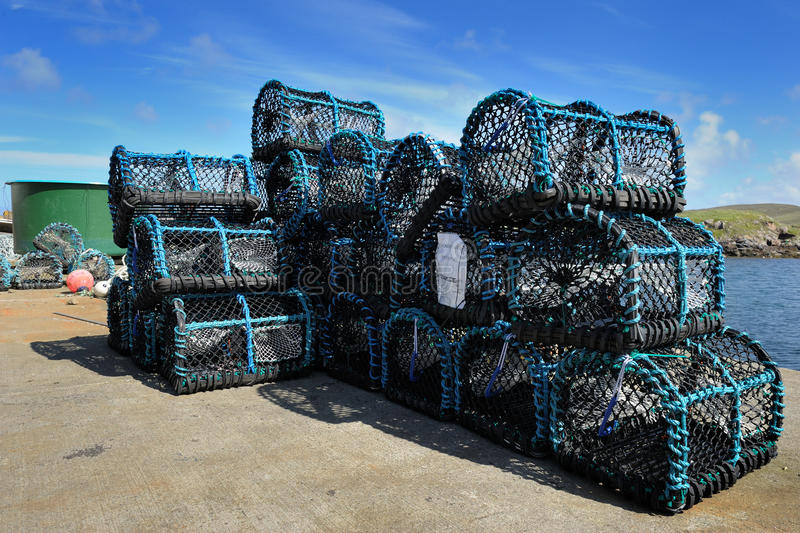 Crab cages. Crab fishing cages on a kay in a scottish harbour royalty free stock images