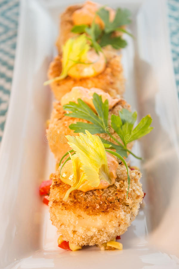 Crab cakes with corn relish royalty free stock photography