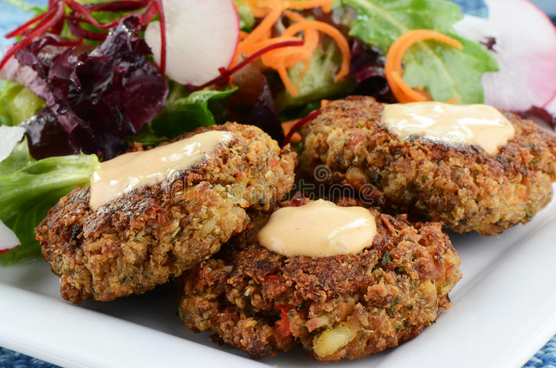 Crab cakes with salad stock photography
