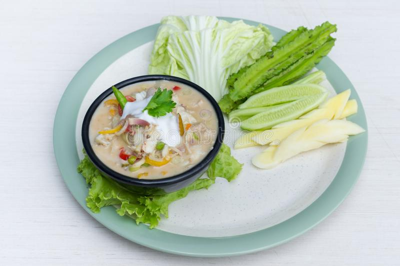 Crab dip with coconut milk and vegetables in bowl stock photography
