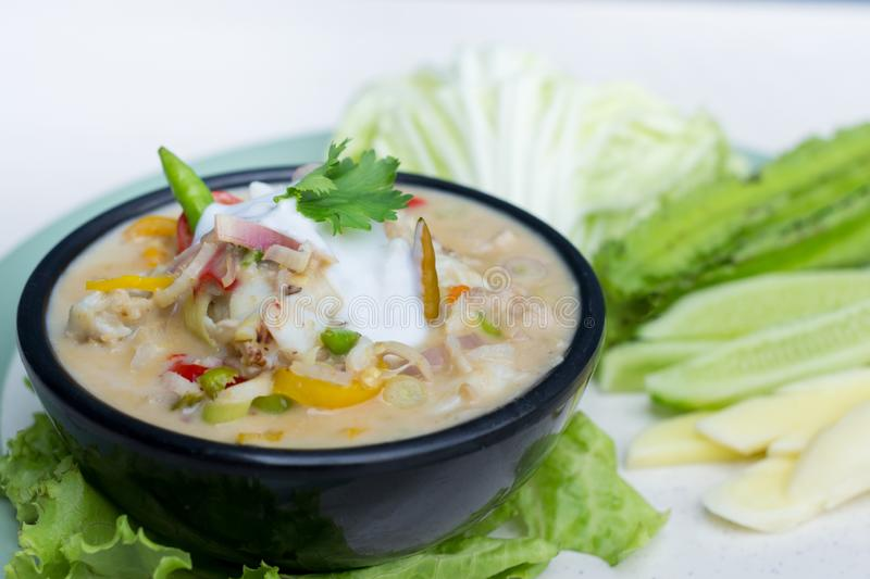 Crab dip with coconut milk and vegetables in bowl royalty free stock images