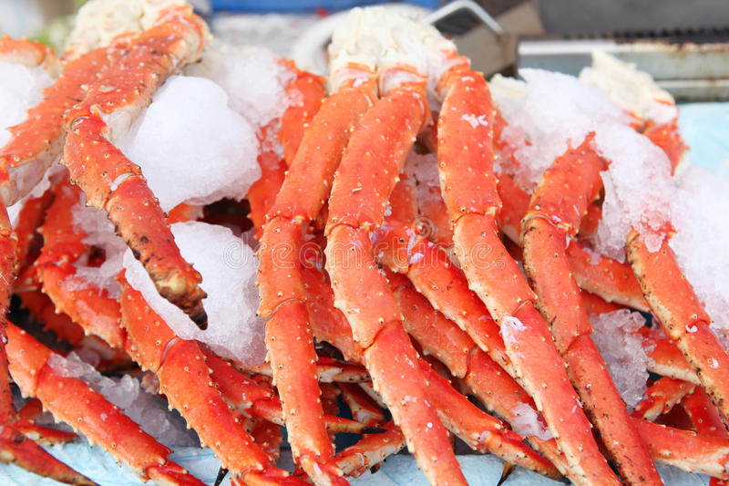 Crab legs at a seafood market. Fresh crab legs at a seafood market royalty free stock photo