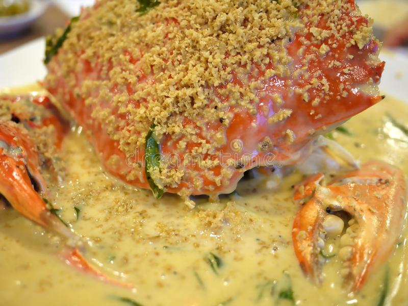 Crab in Pumpkin Sauce. A delicacy in Singapore. Crab cooked in creamy pumpkin sauce stock photography