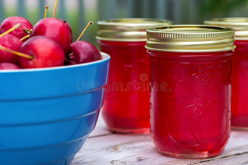 Crabapple Jelly. Fresh crabapples with jars of crabapple jelly royalty free stock photos