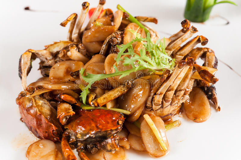 Crabe frit avec le gâteau de riz photographie stock