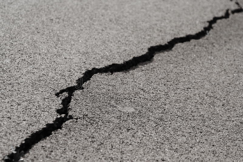 Crack in the asfalt stock images