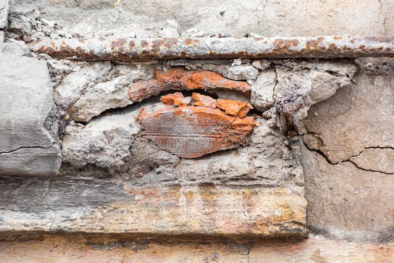Crack in brick wall and rusty pipe. Crack in brick wall and rusty metal pipe, worn, broken, old, concrete, stone, decay, uneven, dirty, destroyed, urban, wreck stock photos