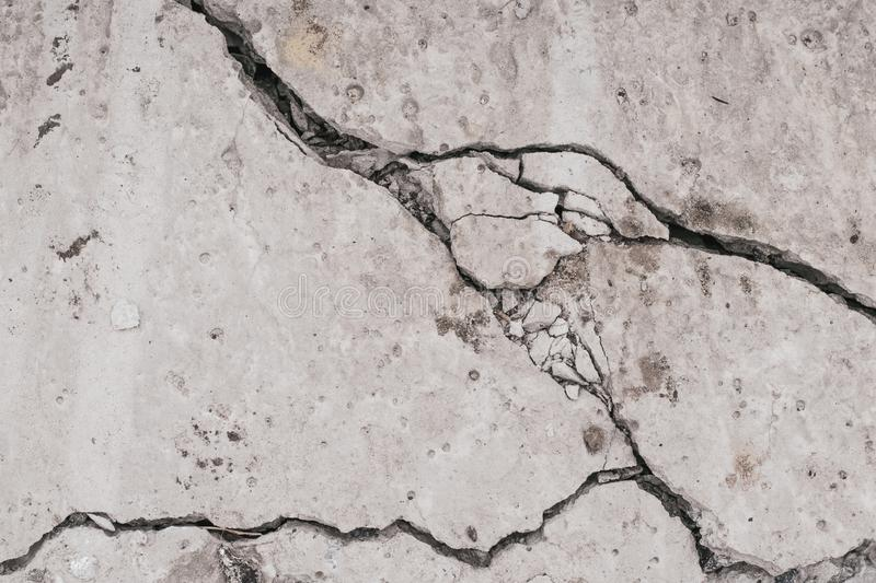 Crack concrete wall. Old dirty cracked wall texture. Gray stone background. Abstract pattern of grunge floor. Messy damage worn of. Broken building stock photography