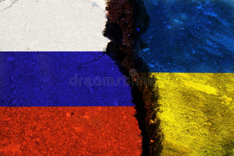 The crack between the flags. Of Ukraine and Russia royalty free stock photos