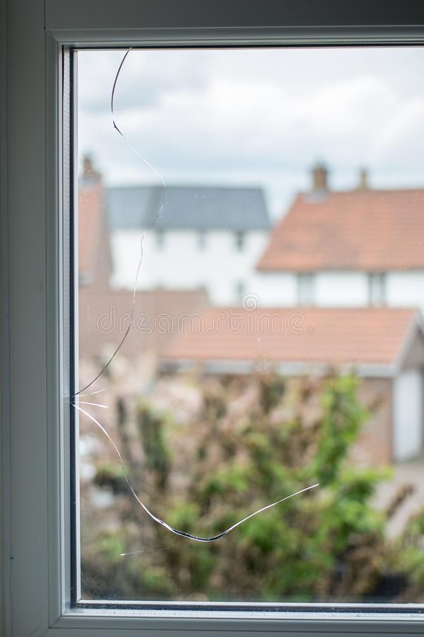 Crack in glass window pane. stock image