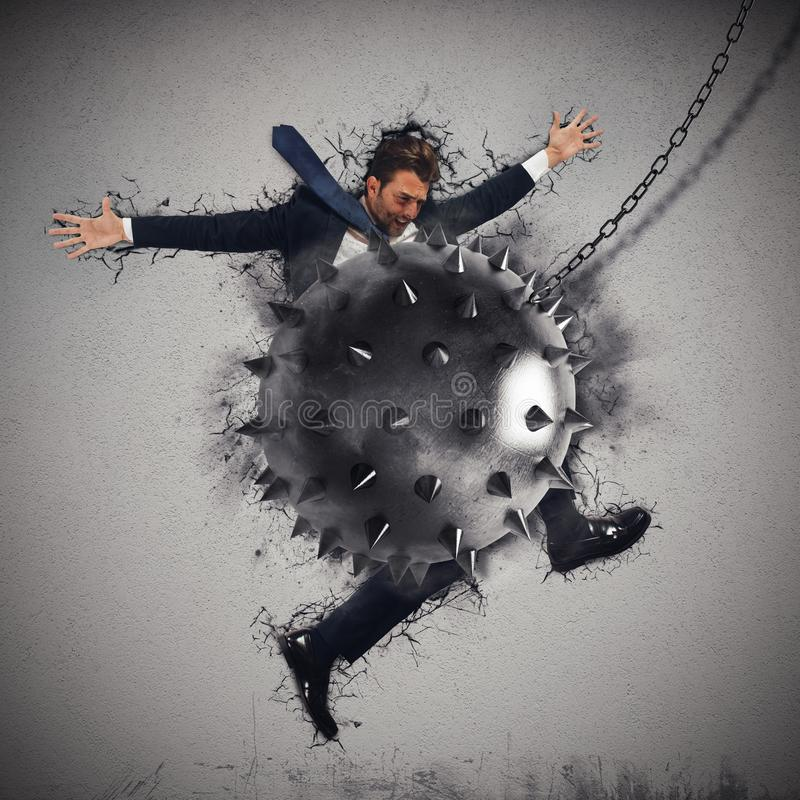Crack by iron ball. Man crushed by a iron sharpened ball royalty free stock images