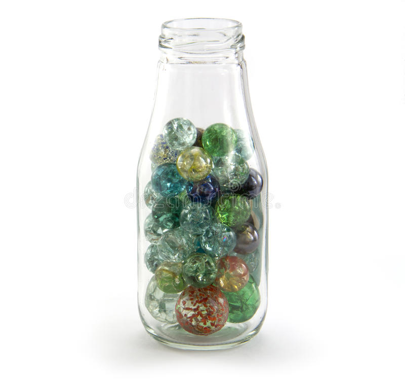 Crack Marbles in a jar stock photos