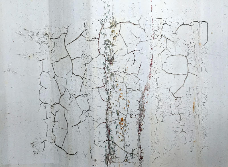 Crack metal background with old layers of white paint. Texture rusted shipping container. stock photography