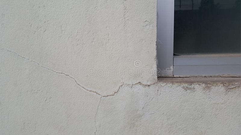 Crack on the old cement wall. Old cement background texture stock images