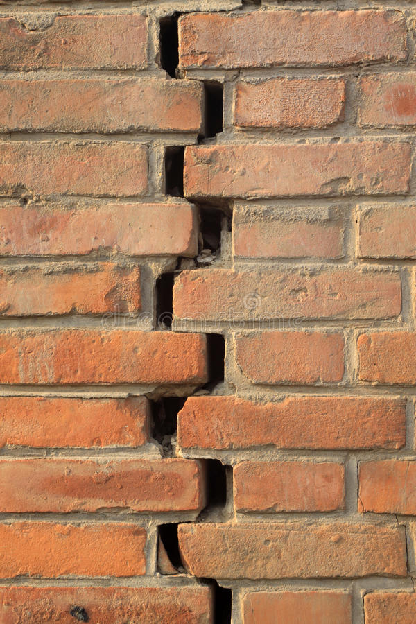 Crack of red brick wall. Closeup of pictures, crack of red brick wall royalty free stock image