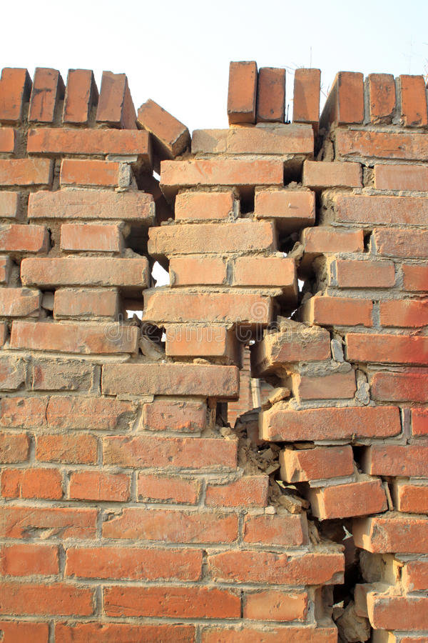 Crack of red brick wall. Closeup of pictures, crack of red brick wall stock photography