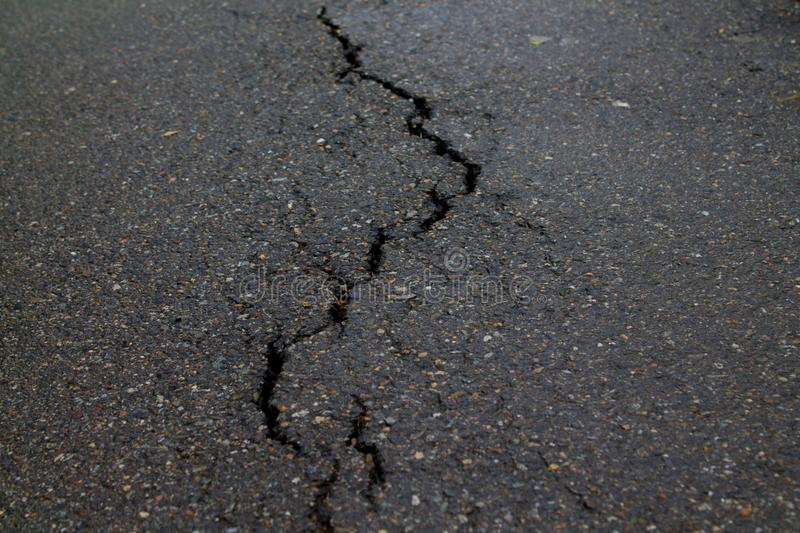 Crack in the road pavement royalty free stock image