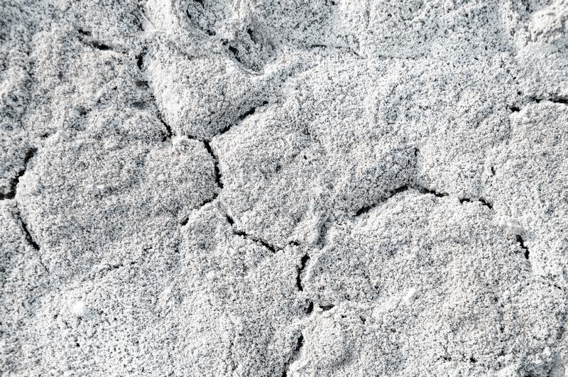 Salt in the soil and cracks stock photography