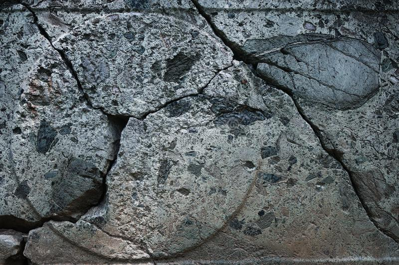 Crack on the surface of the stone close-up, background. Empty space royalty free stock photo