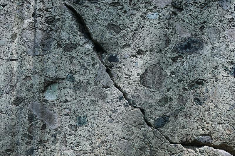 Crack on the surface of the stone close-up, background. Empty space stock photography
