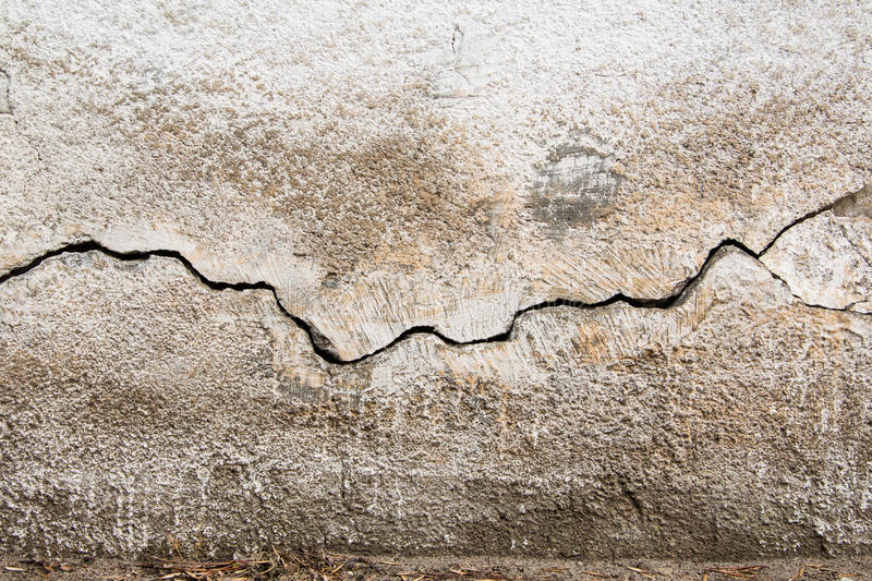 Crack. Texture of old painted white plaster. Cracked wall. stock images