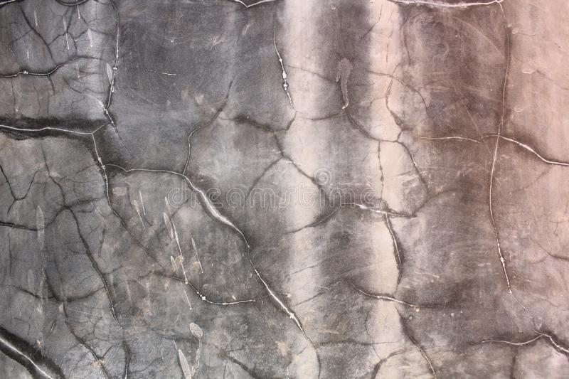 Crack wall background texture. Grey royalty free stock image