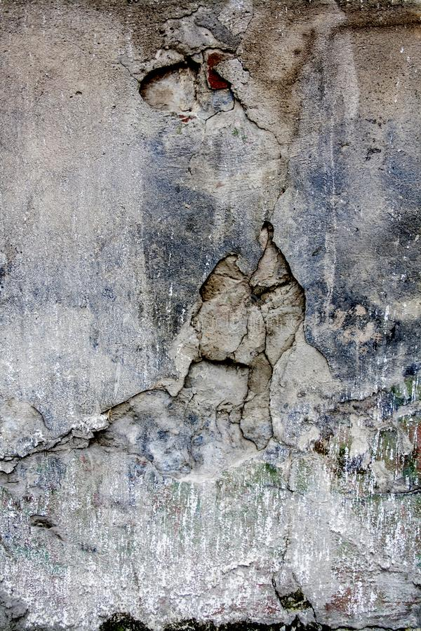 Crack wall brick plaster texture. Old abstract broken architecture background. Scratched stucco. For banner and wallpaper. royalty free stock images