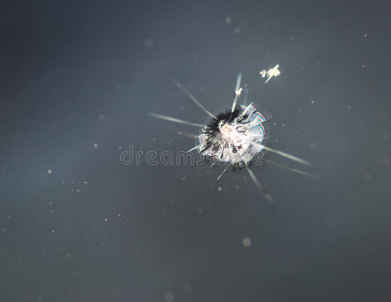 Crack in windshield. Small crack in windshield. Selective focus royalty free stock photo