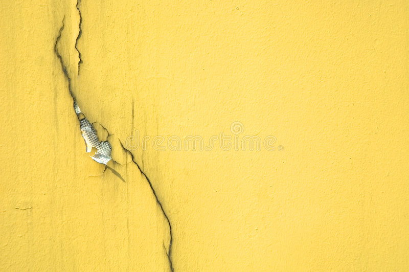 Crack on Yellow Wall royalty free stock images