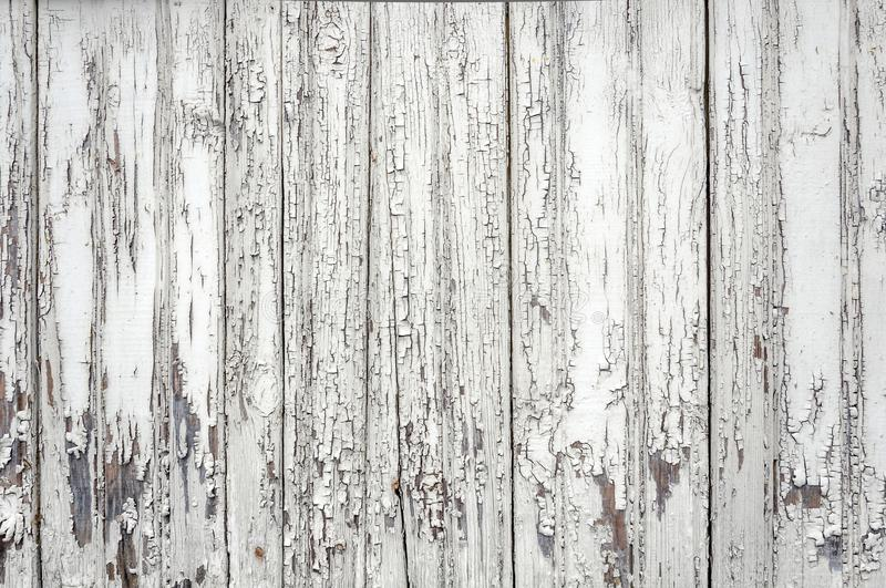 Cracked aged surface white painted wooden planks texture background backdrop stock image