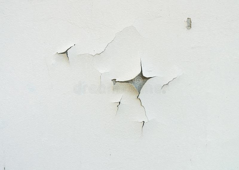 Cracked and aged white wall facade texture or background stock photography