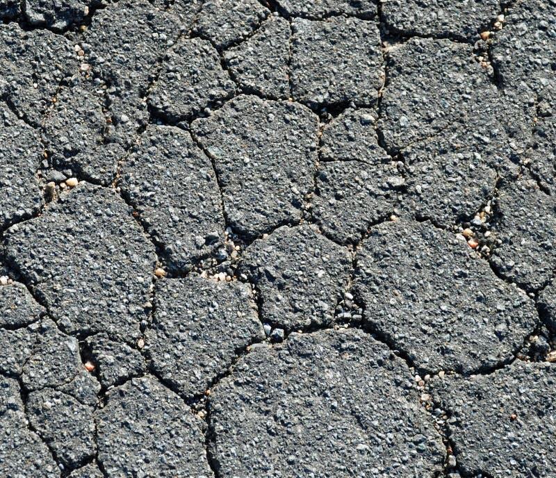 cracked asfaltblack royaltyfri foto