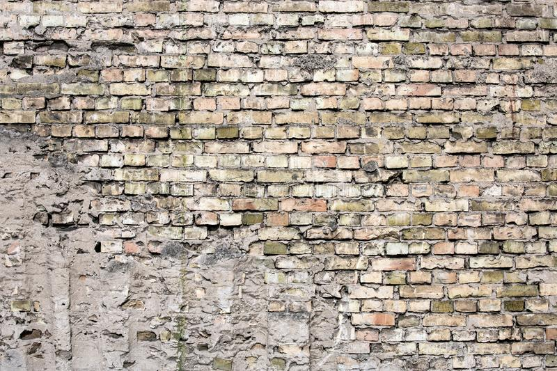 Cracked black brick wall royalty free stock photography