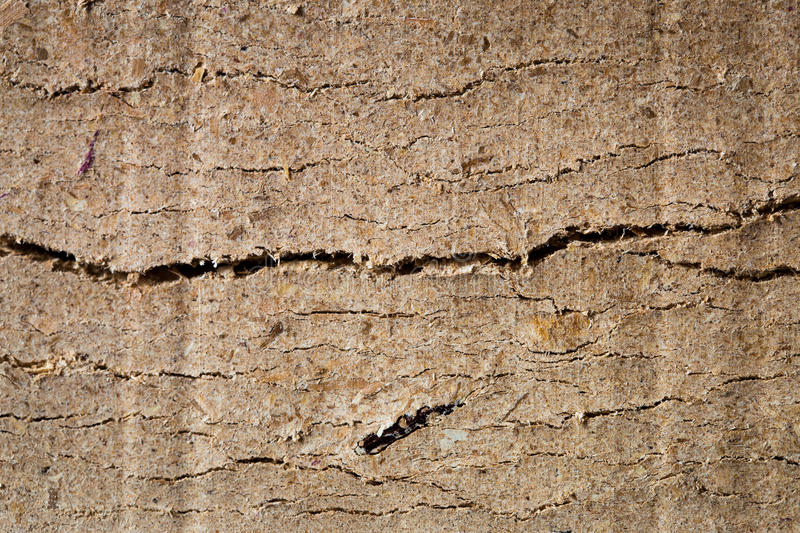Cracked briquette. Side texture view royalty free stock photography