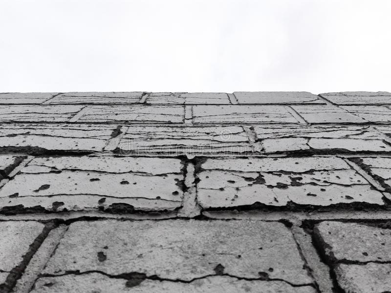 Broken brick wall black and white with sky stock photo