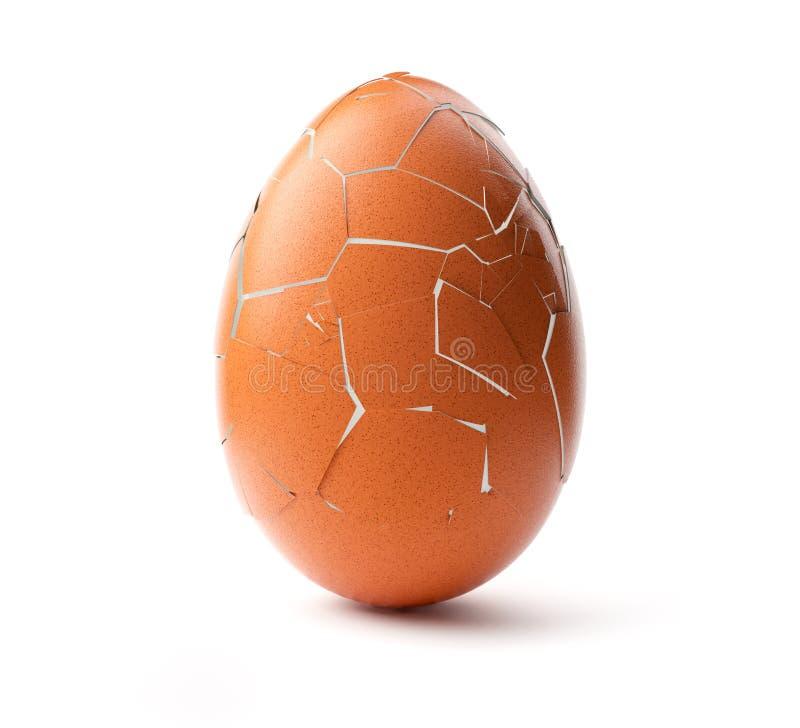 Cracked brown egg. Studio shot royalty free stock image