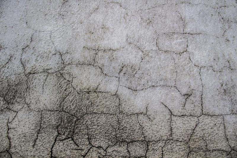Cracked cement wall. Old wall with cracks. Cool. A Grey wall royalty free stock images