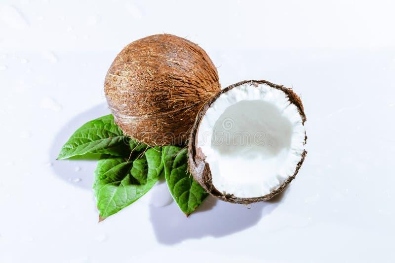 Cracked coconut. With big splash, isolated on white stock image