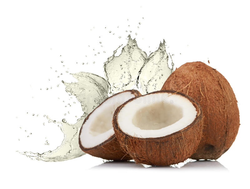 Cracked coconut with splashing water stock photography