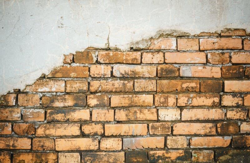 Cracked concrete brick wall stock photos