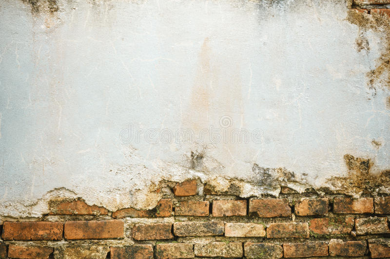 Cracked concrete brick wall royalty free stock photography